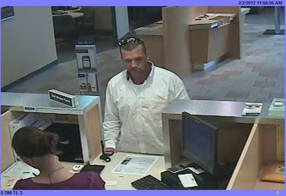 "Surveillance photo of ""tall, dark and handsome bandit."" (Photo submitted by FBI Houston Division)"
