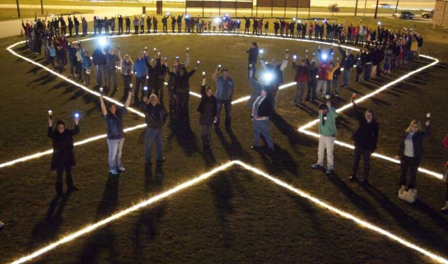 Members of The Way Church in Spring form a 190-person ribbon to raise awareness for human trafficking on Saturday. Photo: Karl Anderson