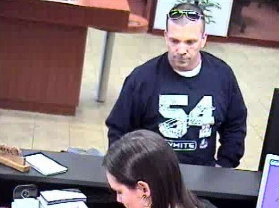 """Maybe the FBI's nickname was premature? Authorities now believe the man responsible for a robbery in southwest Houston Thursday -- dubbed the """"tall, dark, handsome bandit,"""" first struck Monday at this bank in Beaumont. Photo: FBI"""