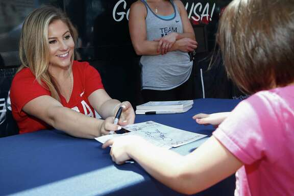 Former Olympian Shawn Johnson East signs autographs at the Team USA Road to Rio Tour Indianapolis on June 25, 2016.