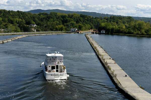 The Kristiania, a 2005 Mikelson 43' Sportfisher, is navigated through the Waterford Flight Locks on its way to North Carolina after being recently purchased in Kenosha Wisconsin on Tuesday, Sept. 27, 2016, in Waterford N.Y. (Will Waldron/Times Union)