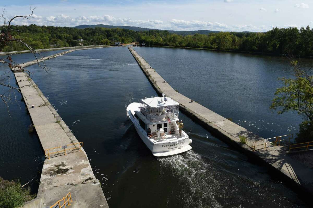 The Kristiania, a 2005 Mikelson 43?' Sportfisher, is navigated through the Waterford Flight Locks on its way to North Carolina after being recently purchased in Kenosha Wisconsin on Tuesday, Sept. 27, 2016, in Waterford N.Y. (Will Waldron/Times Union)