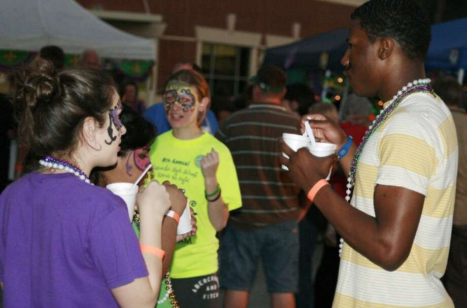 Guests packed the outside patio of Atascocita High School for last year's annual Mardi Gras gumbo/jambalaya cook-off.