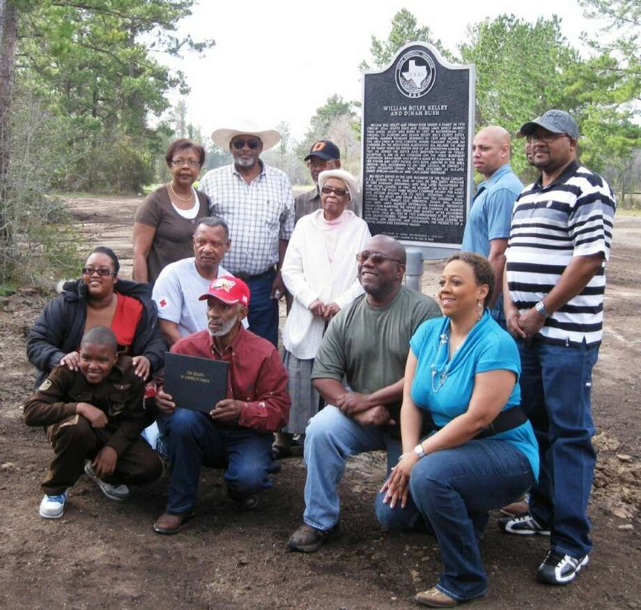 "Descendents of the family pose in front of the historical cemetery marker commemorating the lives of William ""Bill"" Kelley and the love of his life, Dinah Rush that was dedicated in San Jacinto County at the intersection of FM 946 and FM 3018 near Oakhurst on Saturday, Jan. 28."