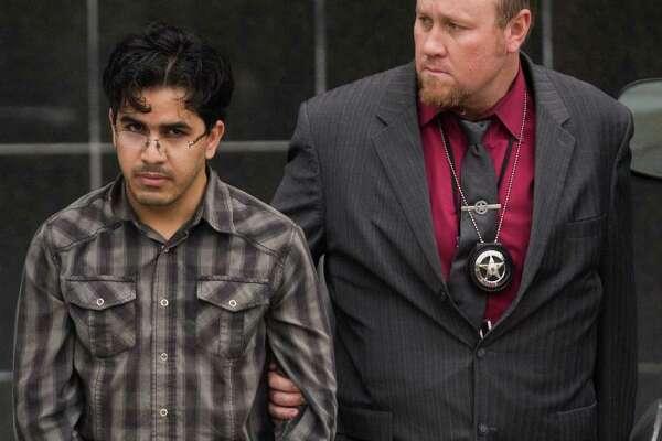 Omar Faraj Saeed Al Hardan, left, walks out of the Bob Casey Federal Courthouse accompanied by U.S. Marshals, Friday, Jan. 8, 2016, in Houston. ( Marie D. De Jesus / Marie D. De Jesus )