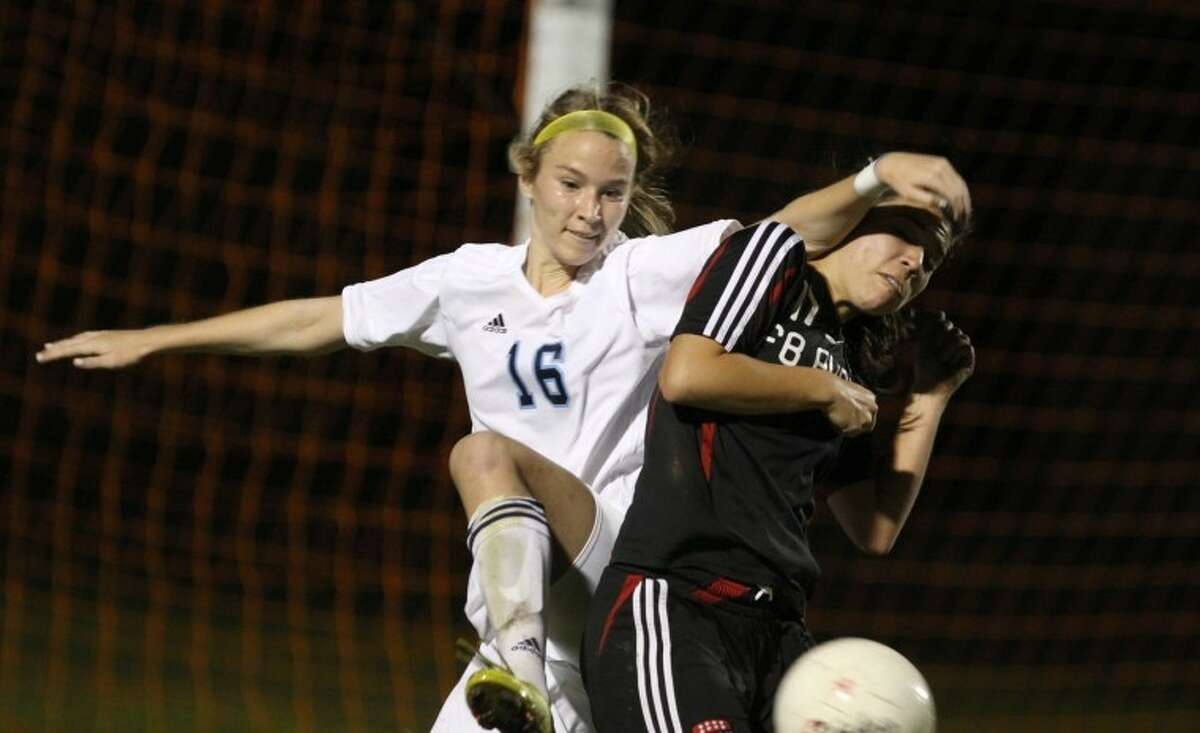 Clements' Lizzy Denton tries to muscle away Meagan Goggans from the ball Friday night. (Photo by Alan Warren)