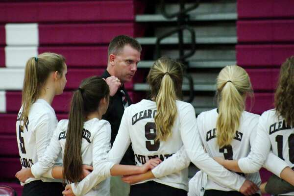 Clear Creek volleyball coach Scott Simonds speaks to his team during a break against Clear Lake Tuesday, Sep. 27.