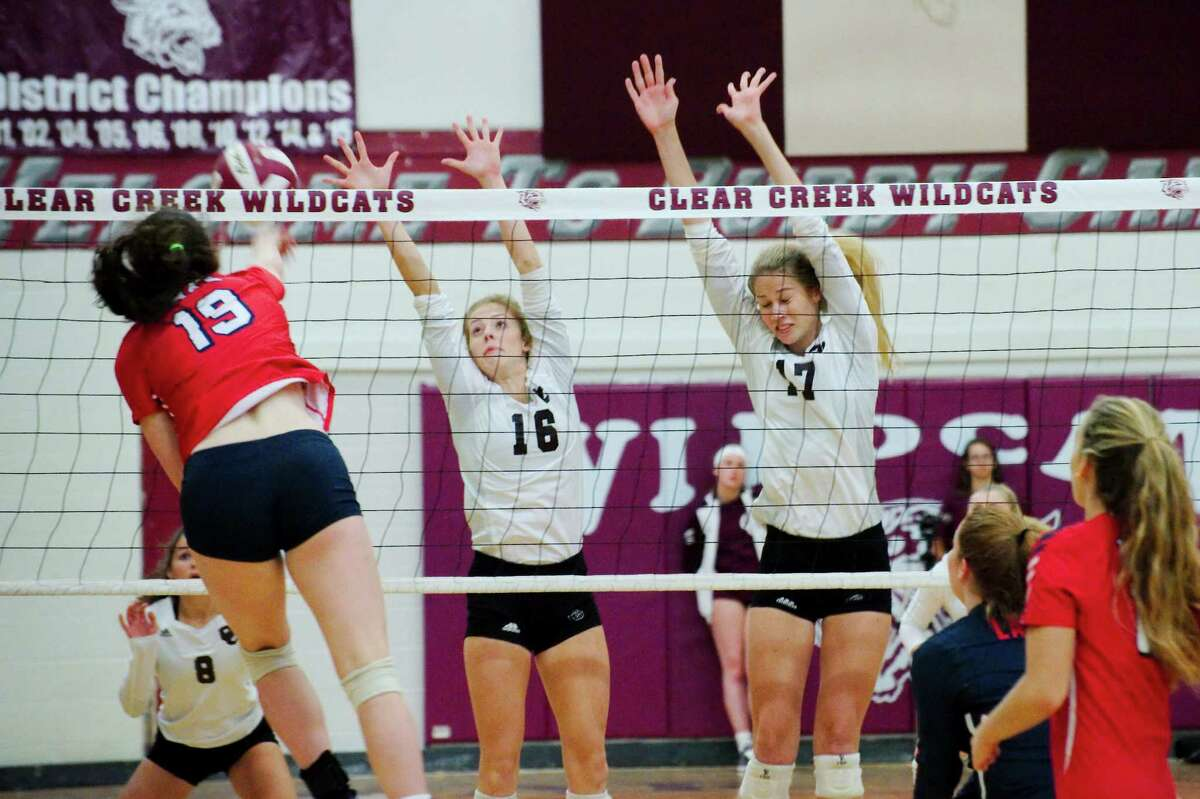 Clear Lake's Brynne Blackmar (19) tries to hit a shot past Clear Creek's Kelsey Childers (16) and Clear Creek's Allie Garland (17) Tuesday, Sep. 27.