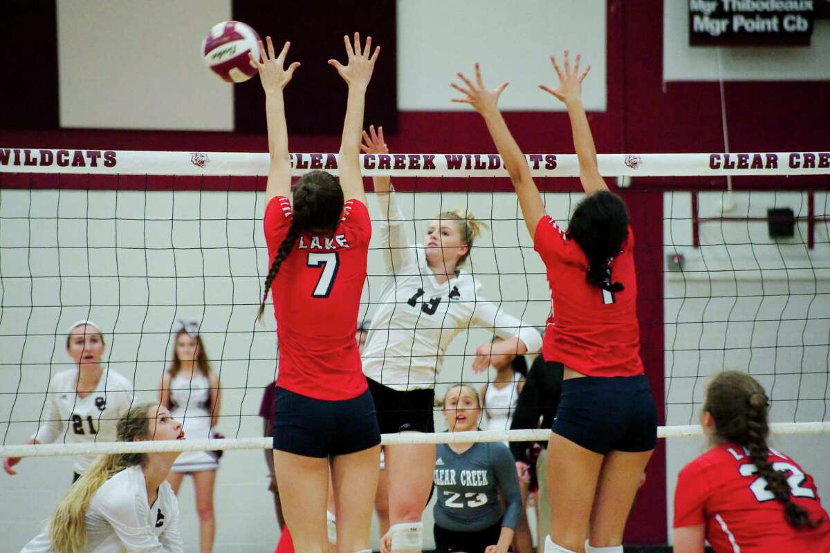 Clear Lake's Lauren Hudson (7) and Clear Lake's Julia Arriazola (1) try to block a shot from Clear Creek's Caitlyn Burroway (13) Tuesday, Sep. 27.
