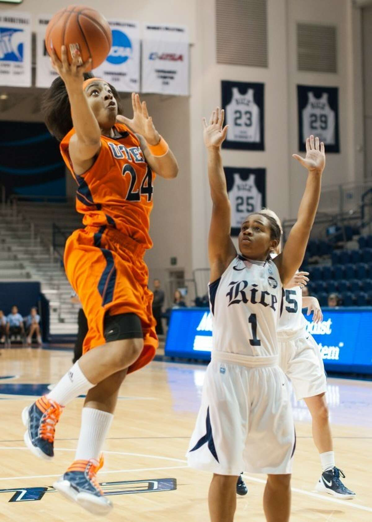 UTEP's Jenzel Nash (Worthing HS) sails in a layup over the head of Rice's D'Frantz Smart in the first. The Miners of UTEP came to Rice to take on the Owls in a rare Sunday morning nationally-televised game the day of the Super Bowl. UTEP broke a late tie to pull ahead and win it 45-41.