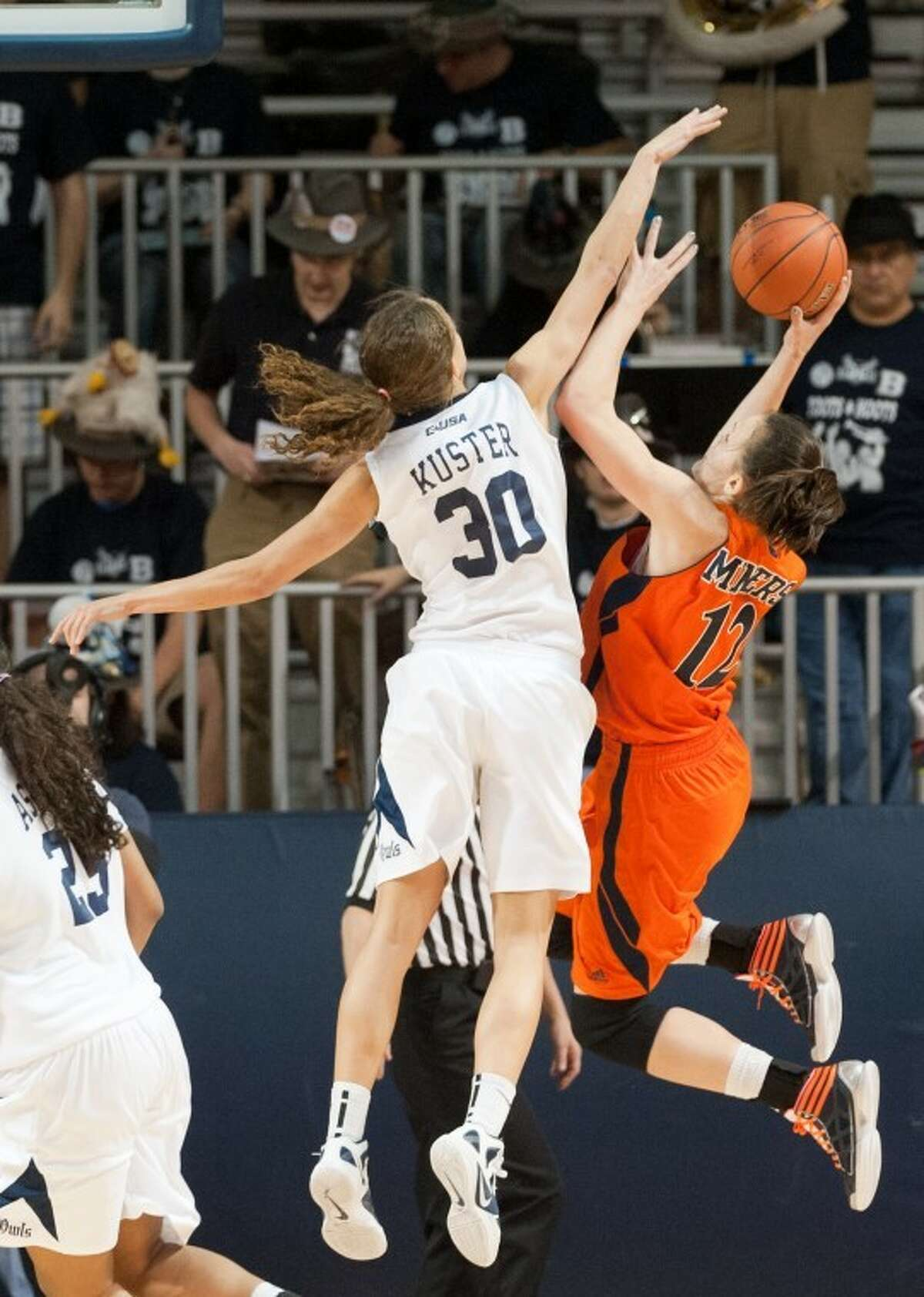 UTEP's Anete Steinberga goes for the basket but is blocked by Rice's Jessica Kuster in the second period. Kuster led the Owls with 11 points, eight rebounds and four blocks.