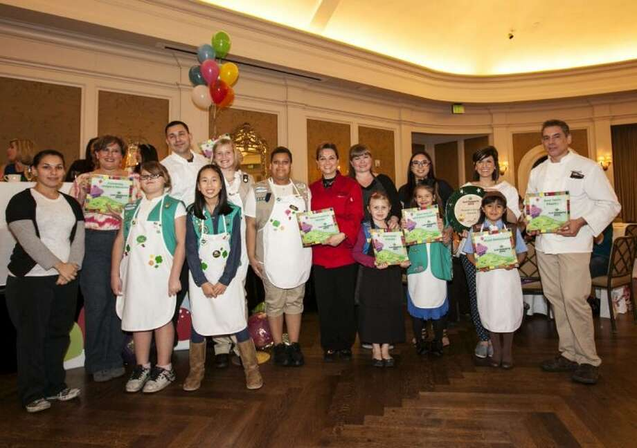 All the celebrity chefs and their Girl Scout assistants show off their awards at the Girl Scouts of San Jacinto Council's Just Desserts event held at The River Oaks Country Club. During the Council's signature donor appreciation event, chefs make original desserts using the infamous Girl Scout Cookie.