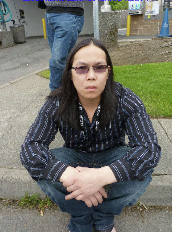 This photo taken by investigators into a Seattle-area drug ring run by Son Tran, 30, shows Tran. Photo: Justice Department Photo