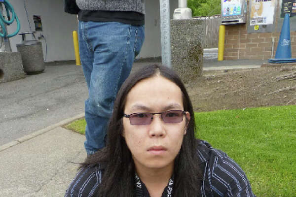 This photo taken by investigators into a Seattle-area drug ring run by Son Tran, 30, shows Tran.