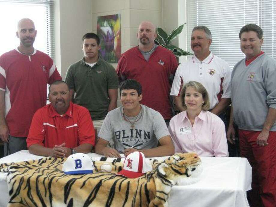 Travis graduate Matt Hernandez (center), pictured celebrating signing with Blinn College during his senior year, was drafted by the Los Angeles Angels in the 23rd round from the University of Houston. Photo: HCN File Photo