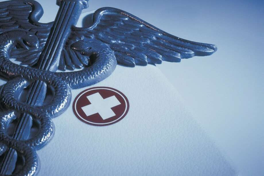 Caduceus with First-aid Kit --- Image by © Royalty-Free/Corbis Photo: © Royalty-Free/Corbis