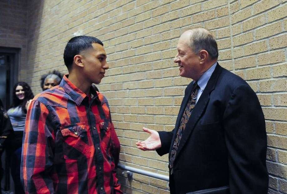 San Jacinto College dual credit student Marco Tapia, left, chats with San Jacinto College Police Chief Bill Taylor at the School Safety Town Hall Meeting that was held at the North Campus. Photo: ROB VANYA