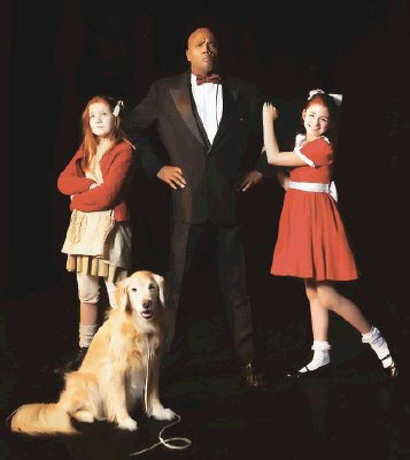 From left, Sister O'Keefe as Sandy, Ella DuCharme as Annie (alternating nights), Michael Moses as Oliver Warbucks, and Natalie Davidson as Annie (alternating nights).
