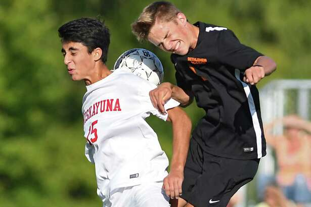 Niskayuna's Kennan Duggal, left, battles to head the ball with Bethlehem's Mark Daley during a soccer game on Tuesday, Sept. 27, 2016 in Niskayuna, N.Y. (Lori Van Buren / Times Union)