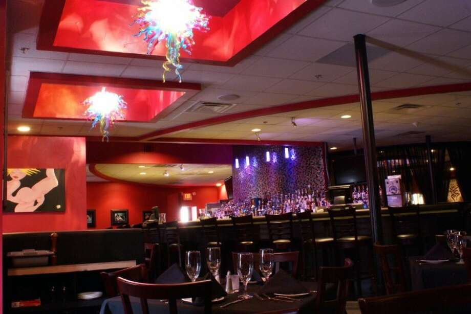 Rich colors, risque art, funky chandeliers and a well-stocked bar create atmosphere at Vida.