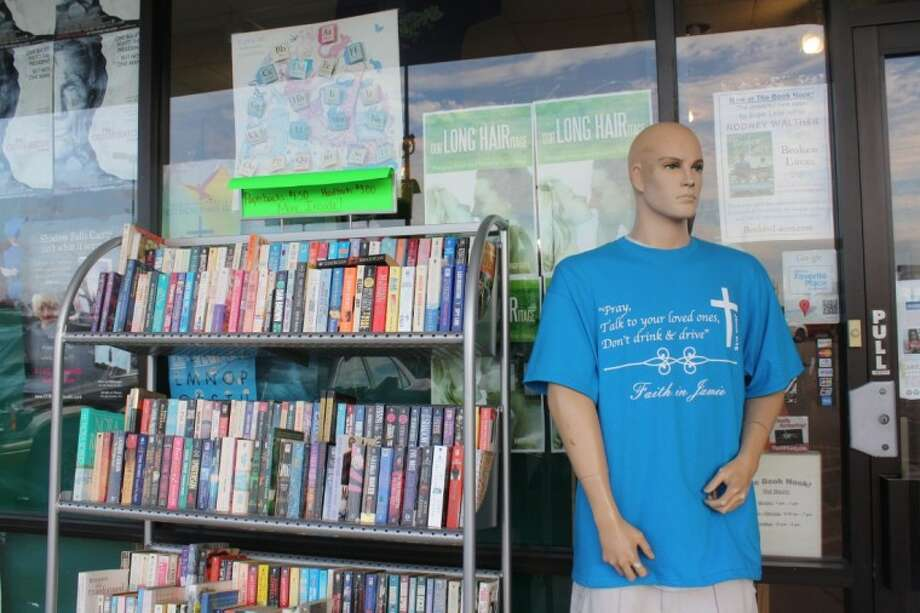 A mannequin greets customers outside of the Book Nook gift shop and book store off Highway 99 and 90. Store owner Katrina Chapman has been worried in recent months about the rising popularity of e-readers and their impact on her business. Photo: Cory Stottlemyer