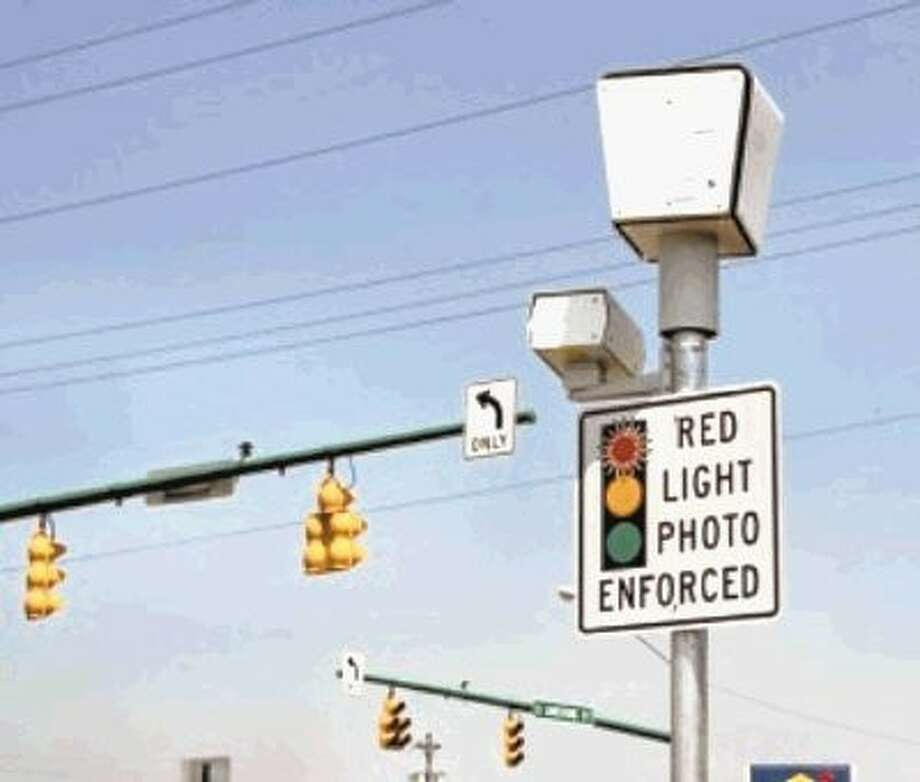 City ends red light camera dispute with settlement / @WireImgId=2513303