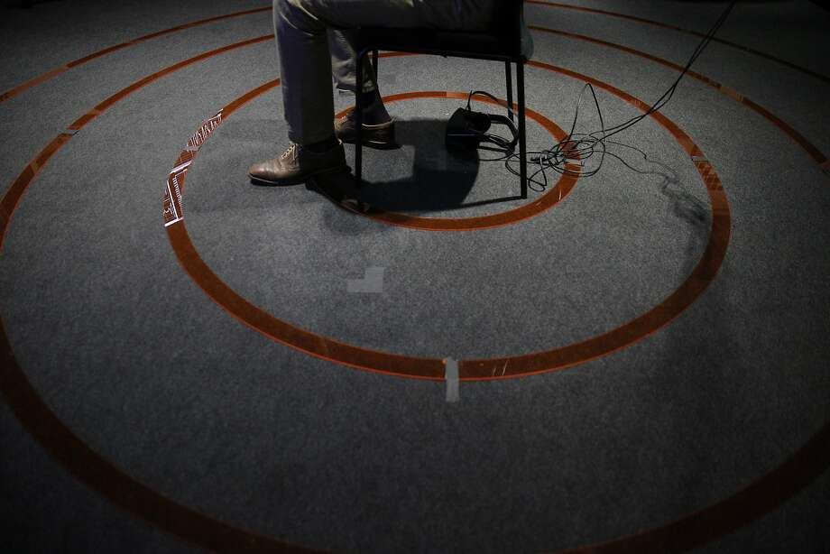 Dolby scientist Evan Gitterman watches a film while having his biological responses monitored in the Biophysical Lab at the Dolby Laboratories in San Francisco, Calif., on Tuesday, September 27, 2016. The concentric rings are used to guage different spatial responses. Photo: Carlos Avila Gonzalez, The Chronicle