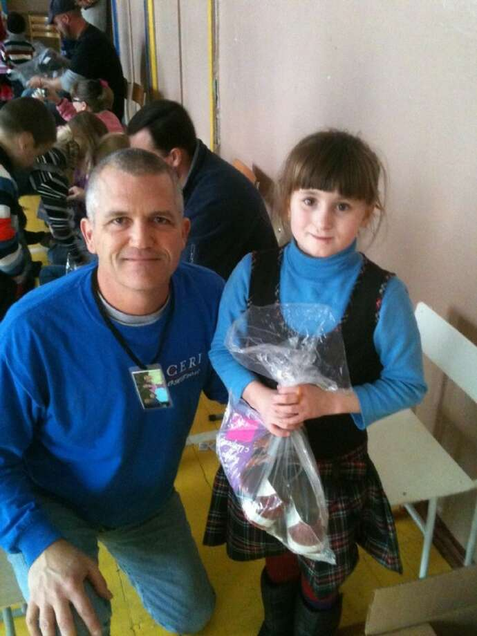 Bethel Baptist Church member Clay Palmer with one of the orphans during the church's recent mission trip to part of Moldova and Transnistria.