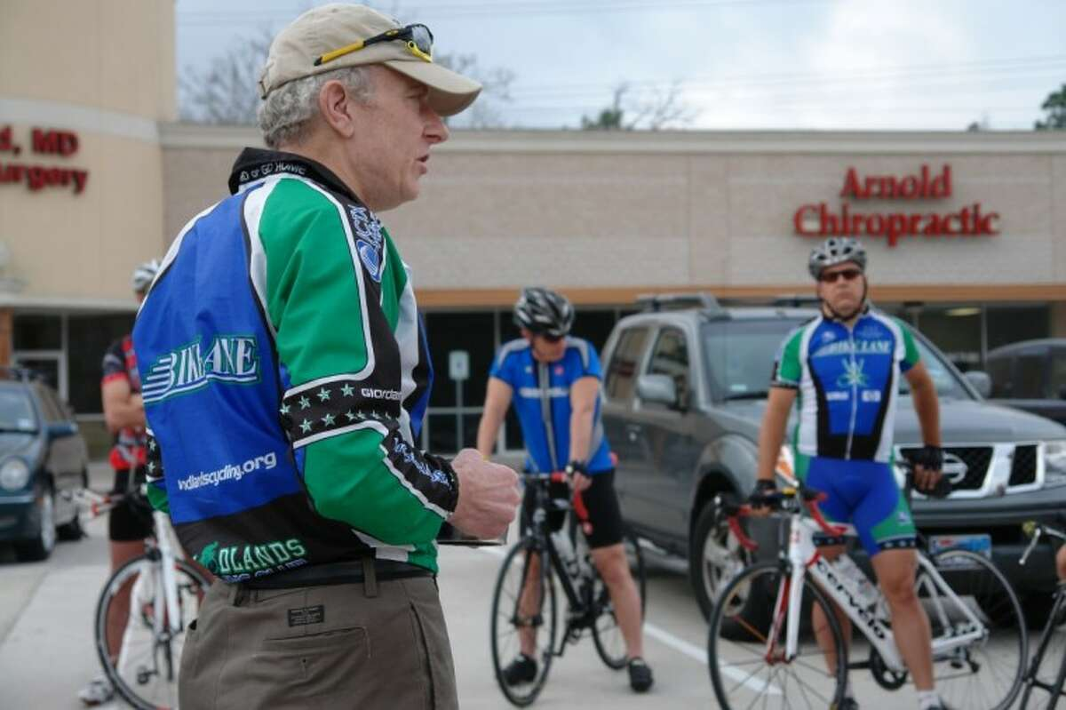 Steve Schoger, treasurer of The Woodlands Cycling Club, speaks to members of the club before a group rides in February. The Woodlands recently was designated a Bicycle Friendly Community.