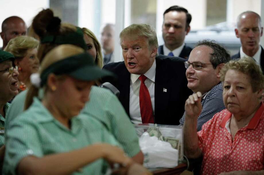 Republican presidential candidate Donald Trump visits a restaurant, Tuesday, Sept. 27, 2016, in Miami. (AP Photo/John Locher) Photo: John Locher, STF / Copyright 2016 The Associated Press. All rights reserved.