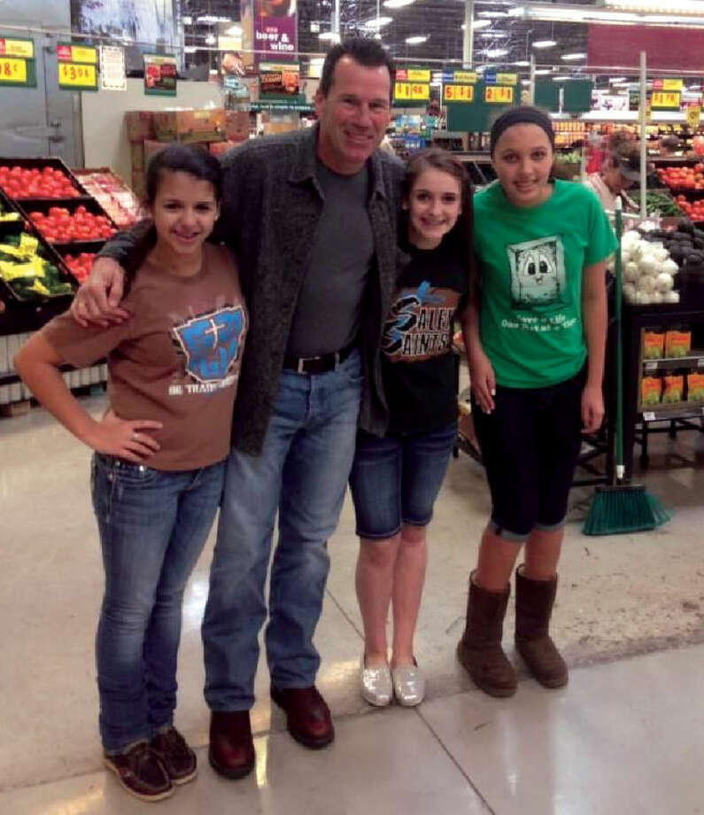 Gary Kubiak, head coach of the Houston Texans, is pictured with Salem School seventh graders Erica Ramirez, Maura Krakosky and Faith Davis. Photo: Submitted Photo