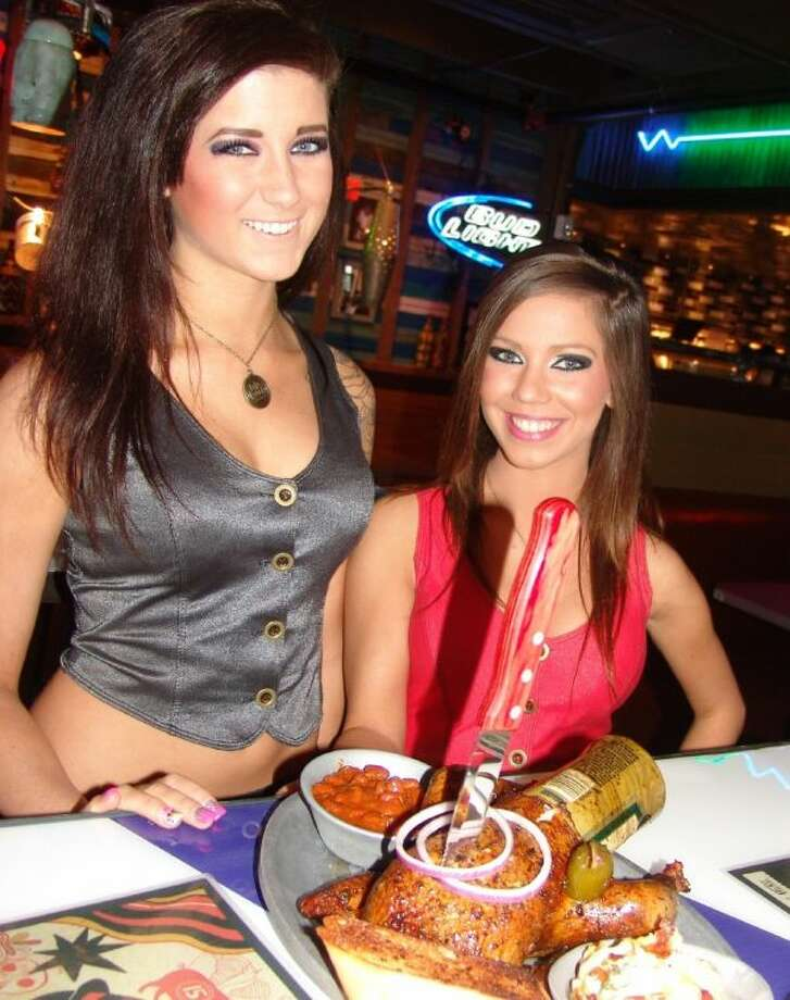"Two Bone Daddy's restaurant waitresses at the new Webster location deliver the ""Beer Can Chicken,"" one of the favorite non-beef menu items. Photo: JEFF NEWPHER"