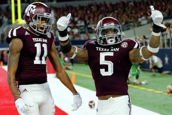 Texas A&M's Josh Reynolds (11), a former Jay High School star, and running back Trayveon Williams celebrate a touchdown run by Williams late in the second half against Arkansas on Sept. 25, 2016, in Arlington. Texas A&M won 45-24.