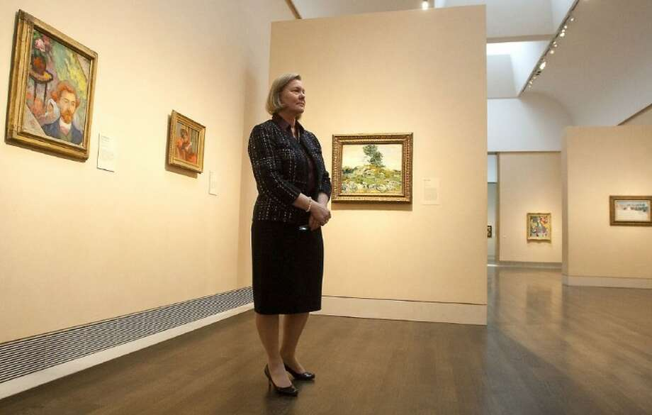 Fifty Impressionist and Post-Impressionist paintings from the National Gallery of Art in Washington, DC has curators at the Museum of Fine Arts Houston a buzz about the exhibit which opens Sunday. Pictured is Helga Aurisch, MFAH curator of European art, in one of the MFAH galleries.
