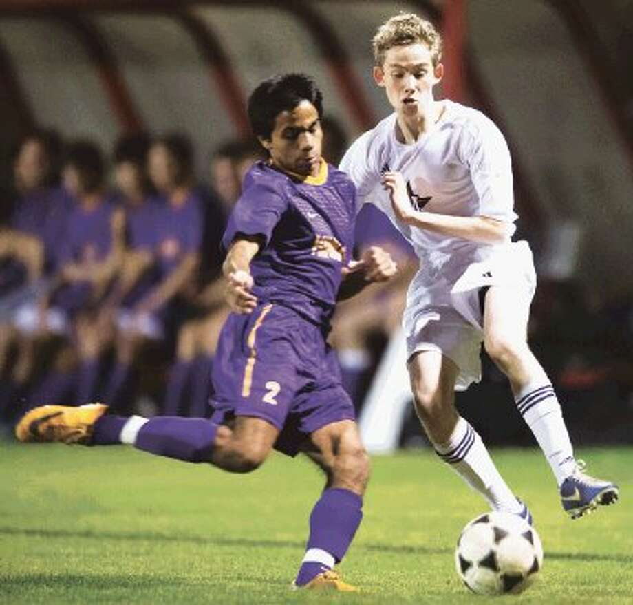 The Kinkaid soccer team, shown here defeating St. John's 2-1 earlier this season, will go for an SPC South Zone undefeated season Friday night when they host Episcopal. The Falcons are now 13-0-2 on the year and 6-0 in the SPC South Zone, but Episcopal has had an excellent season themselves with a 11-2-0 record and they are 4-2 in the SPC South Zone. The Falcons will be the top seed out of the South Zone at next week's SPC tournament. (Kevin B Long / GulfCoastShots.com) Photo: Kevin B Long / ©2013 Gulf Coast Shots. All rights reserved