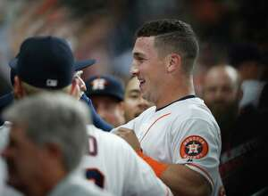 Houston Astros Alex Bregman celebrates his RBI single in the dugout during the sixth inning of an MLB game at Minute Maid Park, Tuesday, Sept. 27, 2016 in Houston.