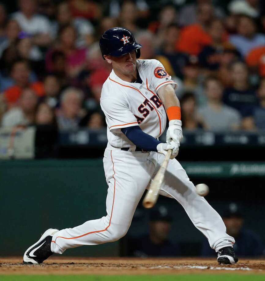 Houston Astros Alex Bregman (2) hits an RBI single during the sixth inning of an MLB game at Minute Maid Park, Tuesday, Sept. 27, 2016 in Houston. Photo: Karen Warren, Houston Chronicle / 2016 Houston Chronicle