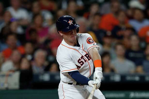 Houston Astros Alex Bregman (2) hits an RBI single during the sixth inning of an MLB game at Minute Maid Park, Tuesday, Sept. 27, 2016 in Houston.