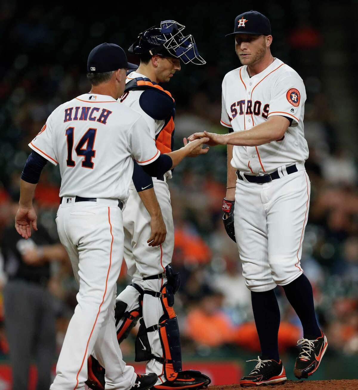 Houston Astros relief pitcher Kevin Chapman (50) gets pulled from the game by manager A.J. Hinch (14) during the sixth inning of an MLB game at Minute Maid Park, Tuesday, Sept. 27, 2016 in Houston.