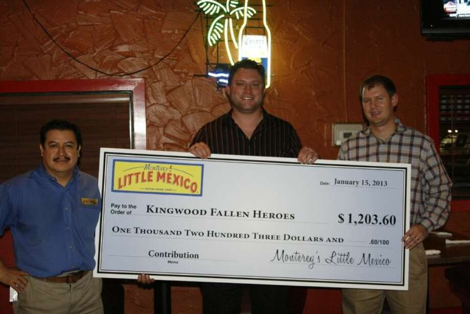 Scott Mitchell, far right, with the Kingwood Fallen Heroes Memorial Golf Tournament was presented with a check from representatives from Monterey's Little Mexico in Humble Jan. 29. Monterey's hosted a special fundraising evening for the memorial foundation to help kick off their golf tournament in April as well as kick off fundraising efforts for the group which support local military charities.