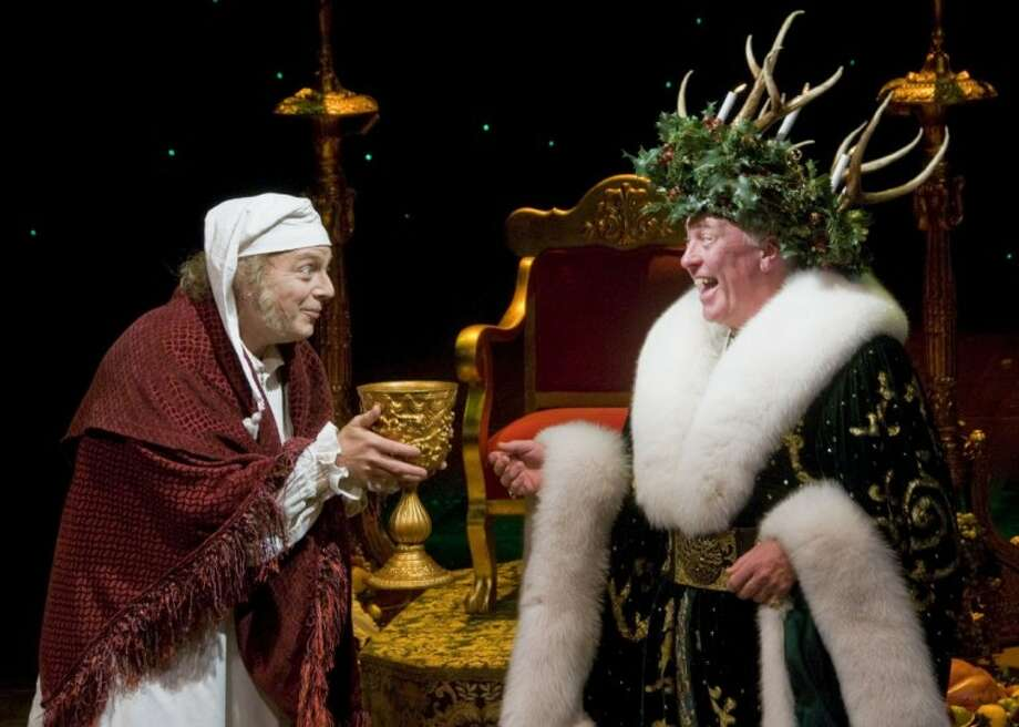Jeffrey Bean as Ebenezer Scrooge and James Belcher as Spirit of Christmas Present in the Alley Theatre's A Christmas Carol - A Ghost Story of Christmas. A Christmas Carol runs on the Alley's Hubbard Stage through December 27.