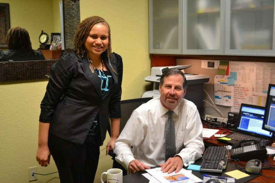 Ambria Jardonae Kirby with Gary Bucek, Consultant at the San Jacinto Small Business Development Center Photo: AISD