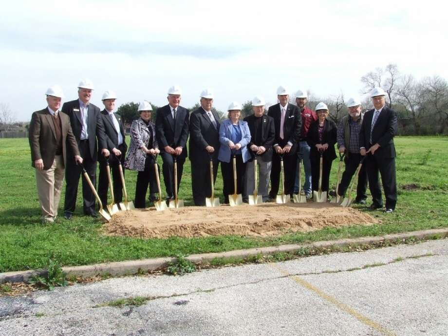 Deer Park Library Director Rebecca Pool, center, is surrounded by community leaders for the groundbreaking of the library expansion project on Monday afternoon. Photo: Jeri Martinez