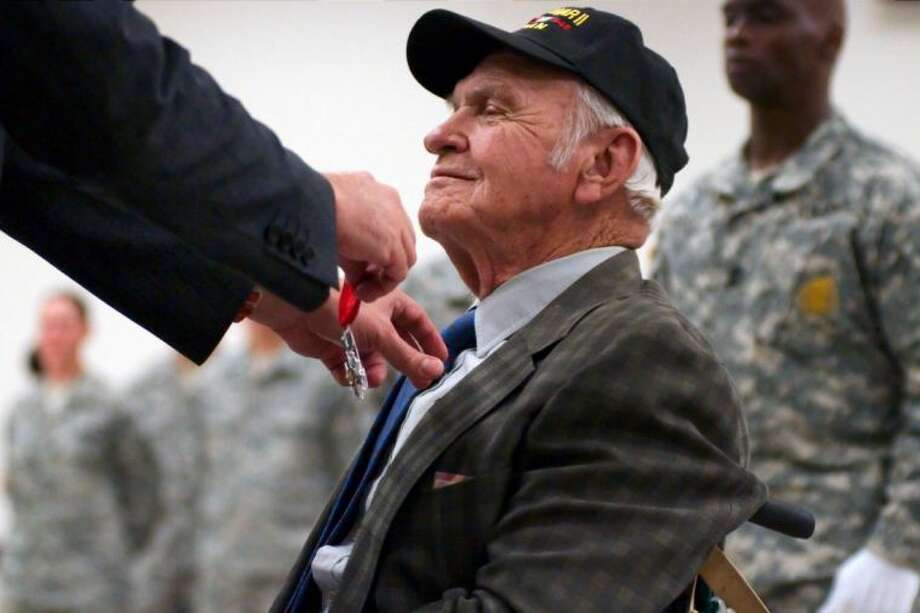 WWII veteran Ralph Miller smiles as he receives the French Legion of Honor Award from Consul General of France Frederic Bontems during a ceremony honoring the veterans for their wartime service to France at Ellington Airport on Thursday, Jan. 31. Photo: Kirk Sides