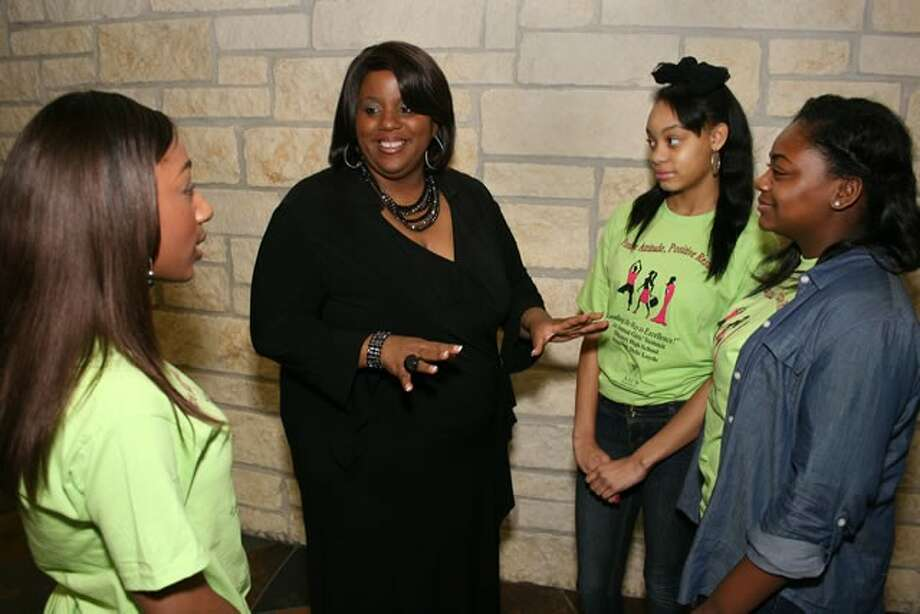 Joie Rasberry, Texas Southern University, center, discusses college and career pathways with Dekaney High School ninth graders, from left, Nakayla Johnson, G'onni Howell and Mykell Johnson.