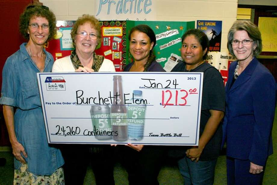 Burchett Elementary receives a check worth $1,213 for collecting and recycling thousands of beverage containers. From left, are Patsy Gillham and Mary Wood, Texas Bottle Bill Team; Lesli Garrett and Jessica Gutierrez, Burchett PTO; and Joan Harding, Burchett principal.