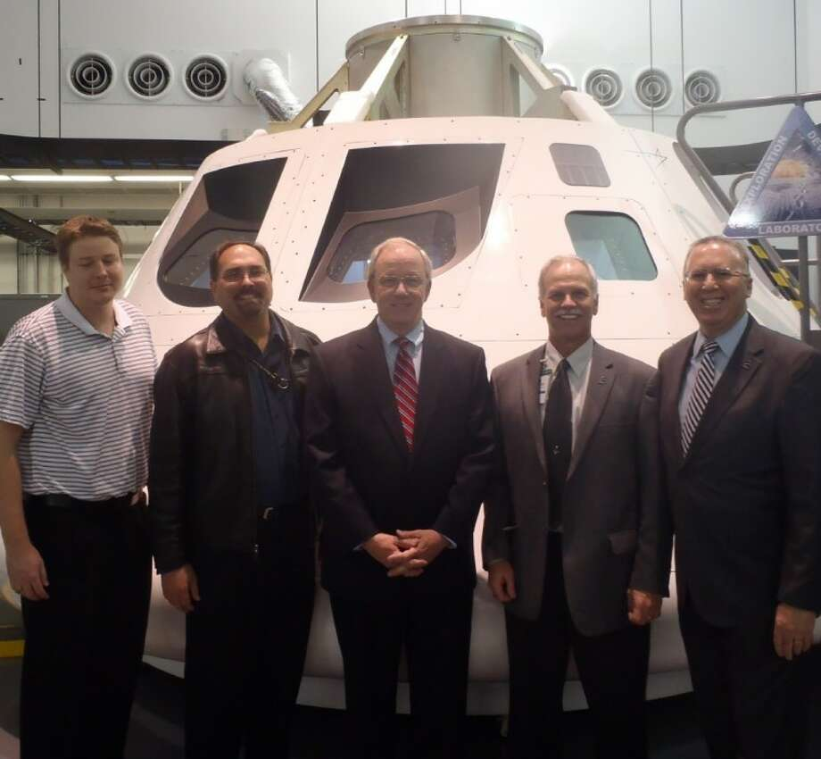 Houston City Councilman Mike Sullivan, center, got an informative tour of the Orion Multi-Purpose Crew Vehicle at the Lockheed Martin Development Lab Feb. 2 in Webster. Orion is being developed for crewed missions to an asteroid and then to Mars and as a backup vehicle of cargo and crewed missions to the International Space Station. The MPCV's debut for the Exploration Flight Test 1 is scheduled for 2014. With him are, from left, Will Wolfe and Wayne Wondra, Blaine Brown and Joe Mayer, all of Lockheed Martin.