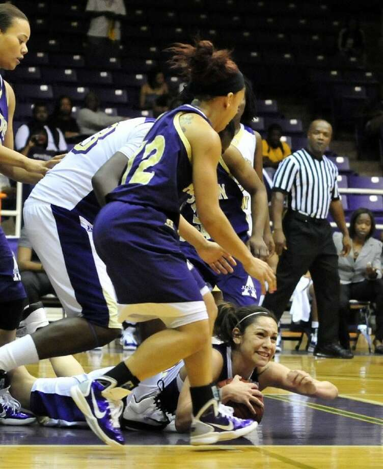 Siarra Soliz holds the ball while looking for help Thursday during the Lady Panthers 55-53 win over Alcorn State.