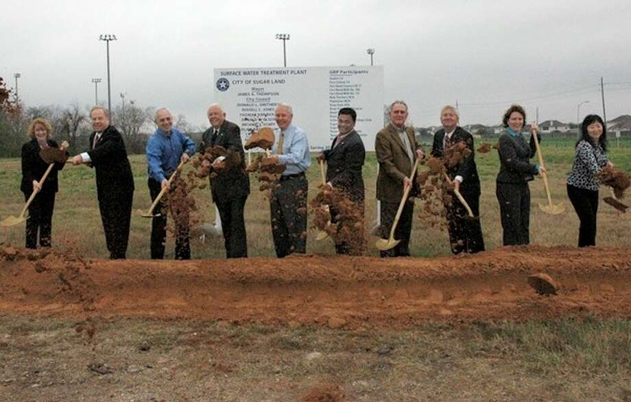 Pictured (L-R) during a groundbreaking event for the surface water treatment plant were Staggs; Bogard; Councilmembers Michael Schiff and Donald L. Smithers; Mayor James A. Thompson; Councilmembers Thomas Abraham, Donald G. Olson and Russell Jones; Assistant City Manager Karen Daly; and Assistant Utilities Director Jessie Li.