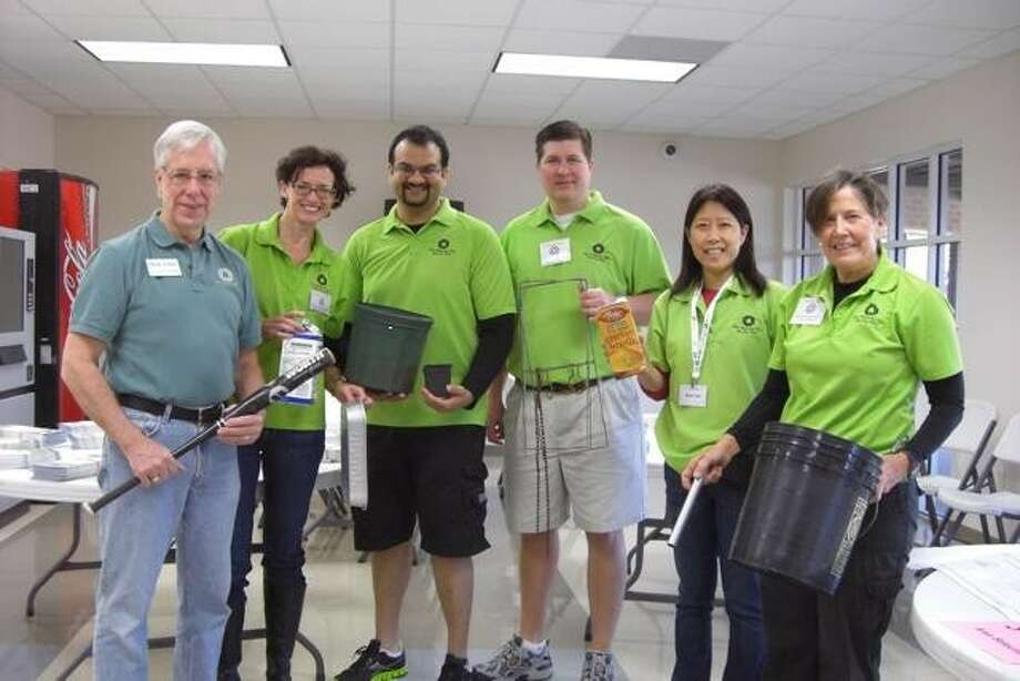 West U City Councilman Dick Yehle, left, joined volunteers and members of the Recycling and Solid Waste Reduction Board, from left, Edwina Forrester, Ankur Kadakia, David Jennings, Mimi Tsai and Yvonne Jacobs, to distribute the latest news on curbside recycling.